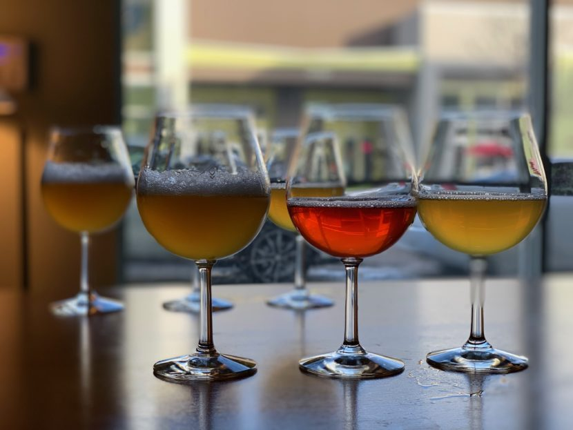 A row of lambic-style beers in glasses from Primitive Beer in Longmont, Colorado.