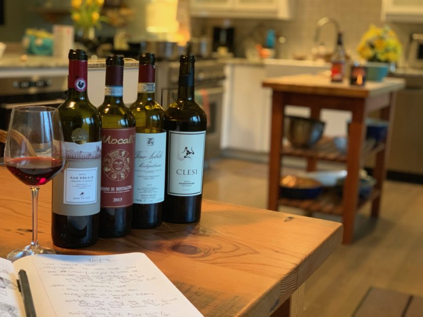 Four bottles of wine from Sangiovese grapes on a butcher block in a Boulder, Colorado home.