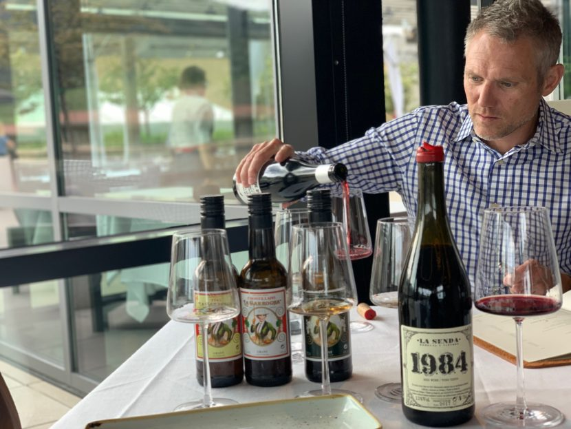 Spanish wine is a passion for Bryan Dayton, the owner of Corrida in Boulder, who is pouring a glass of Spanish wine in his restaurant.