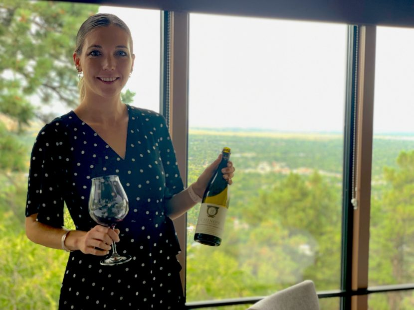 Elizabeth Sammuri, the beverage director at Flagstaff House in Boulder, Colorado, holding a bottle of Chinon Cabernet Franc.